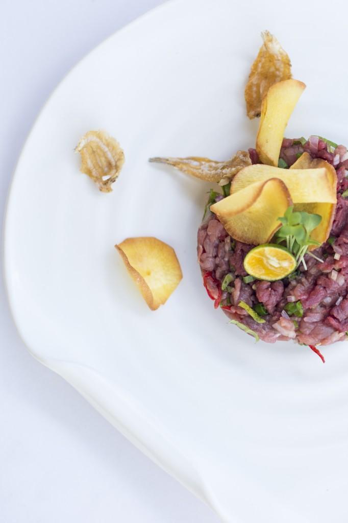 Beef tartar with sambal ulek mustard seed shallots cassava chips and ikan asin